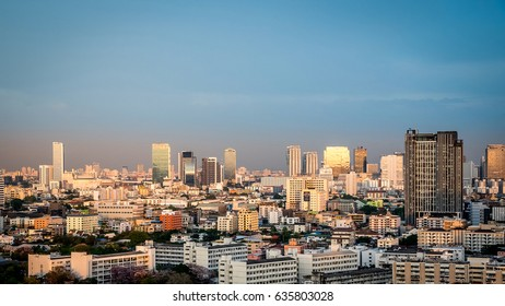 Bangkok, Thailand - April 8, 2017 : Cityscape and transportation with expressway and traffic in evening from skyscraper of Bangkok. Bangkok is the capital and the most populous city of Thailand.