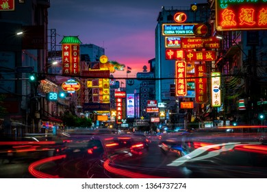 Bangkok, Thailand - April 8, 2019: Evening colorful sign and the light trails from car moving on the night of Yaowarat Road at main street in Bangkok's Chinatown