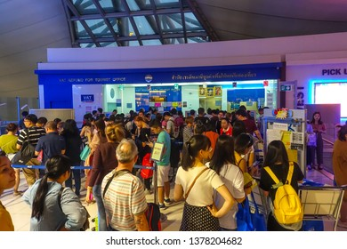 Bangkok, Thailand - April 8, 2019 : Tourists line up to collect their cash refund at the a VAT (Value Added Tax) Refund For Tourist Office at Suvarnabhumi Airport