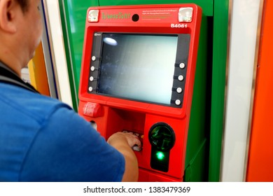 Bangkok, Thailand - April 8, 2019 : close up of an adult male using an Automated Teller Machine (ATM) at MBK Plaza