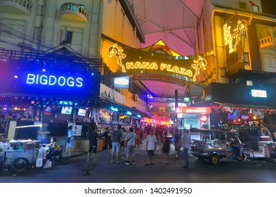 Bangkok, Thailand - April 8, 2019: View of the entrance of Nana Plaza, a red light district area of Bangkok in a courtyard of Sukhumvit Soi 4 with people in a motion blur.
