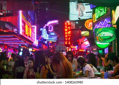 Bangkok, Thailand - April 8, 2019: Soi Cowboy, one of the red light district areas of Bangkok, with people in a motion blur by night.