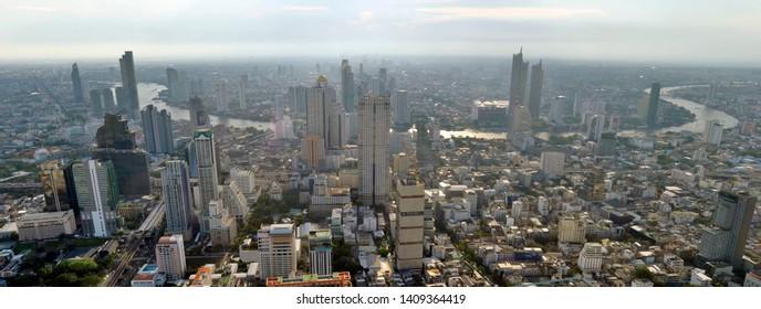Bangkok, Thailand - April 8, 2019: High angle view of the Bangkok skyline and the Chao Phraya river from the King Power MahaNakhon.