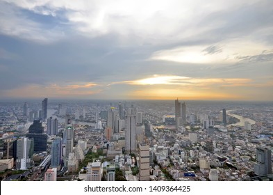Bangkok, Thailand - April 8, 2019: High angle view of the Bangkok skyline and the Chao Phraya river at sunset from the King Power MahaNakhon.