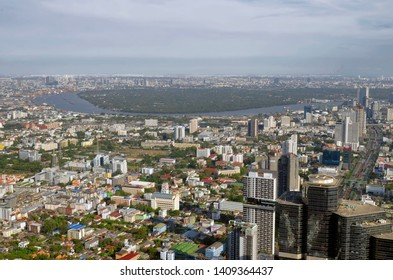 Bangkok, Thailand - April 8, 2019: High angle view of the Bangkok skyline, Bang Kachao and the Chao Phraya river from the King Power MahaNakhon.