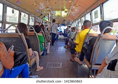 Bangkok, Thailand - April 8, 2019: Inside a red city bus in Banglamphu.