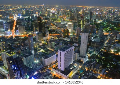 Bangkok, Thailand - April 8, 2019: High angle view of the Bangkok skyline by night from the King Power MahaNakhon.