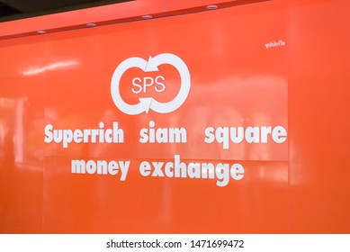 Bangkok, Thailand. April 8, 2019. Signage announcing the Superrich Siam Square money changer kiosk at the Siam Paragon shopping mall.
