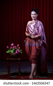 BANGKOK, THAILAND – APRIL 8: The girl in a beautiful pink Thai dress on April 8, 2019 in Bangkok, Thailand.
