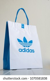 BANGKOK, THAILAND - APRIL 9, 2018: Paper bag Adidas original logo for product Adidas original  . Adidas - German industrial group specializing in the production of athletic footwear, apparel.