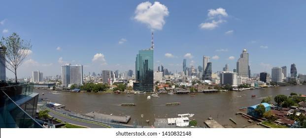 Bangkok, Thailand - April 9, 2019: The Bangkok skyline seen from the Icon Siam mall.