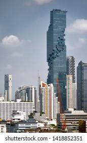 Bangkok, Thailand - April 9, 2019: View of the King Power MahaNakhon among the city skyline.