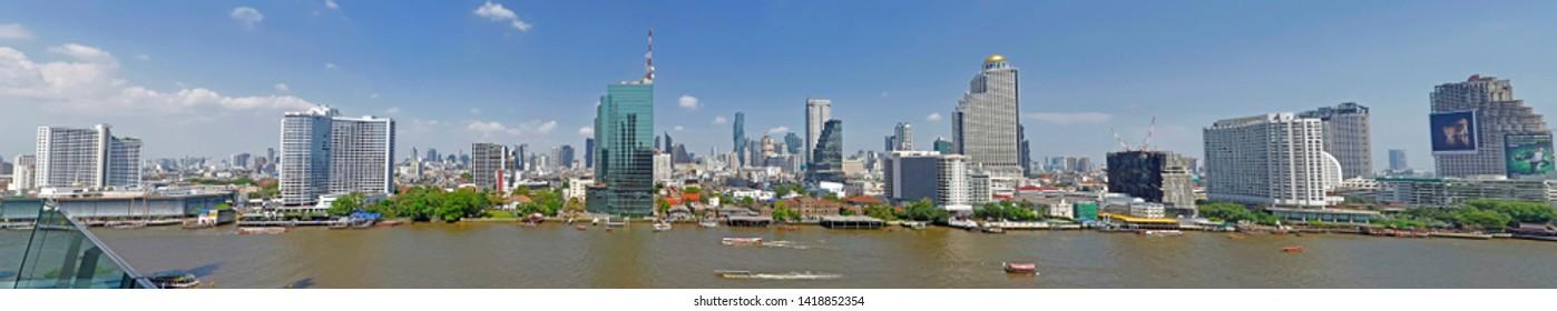 Bangkok, Thailand - April 9, 2019: The Bangkok skyline seen from the Icon Siam shopping mall.