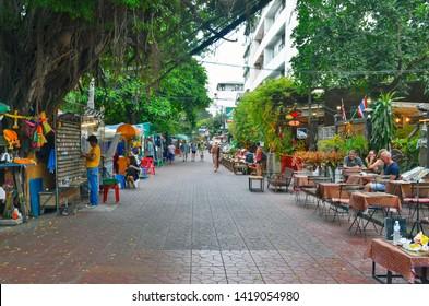 Bangkok, Thailand - April 9, 2019: Soi Rambuttri, a bustling pedestrian paved alley near Khao San Road full of bars, restaurants, street food stalls, street vendors, massage parlors and guesthouses.