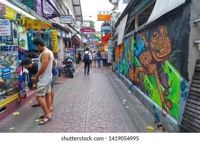 Bangkok, Thailand - April 9, 2019: Soi Chana Songkhram, a bustling pedestrian paved alley between Phra Athit road and soi Rambuttri near Khao San Road.