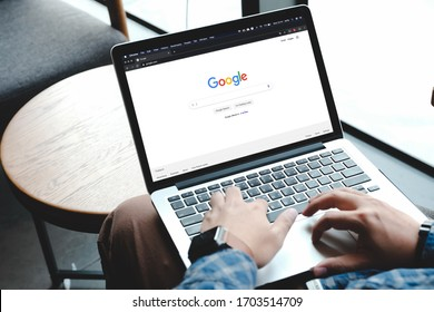 Bangkok. Thailand. ARP 12,2020 :A man is typing on Google search engine from a laptop. Google is the biggest Internet search engine in the world.