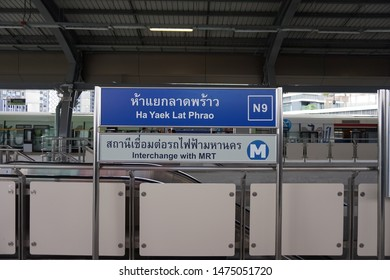 Bangkok, Thailand - Aug 10, 2019: Label of BTS Ha Yaek Lat Phrao station at noon. Name tag of BTS sky train. Notice of interchange with MRT. Which this station opened on 9 August 2019.