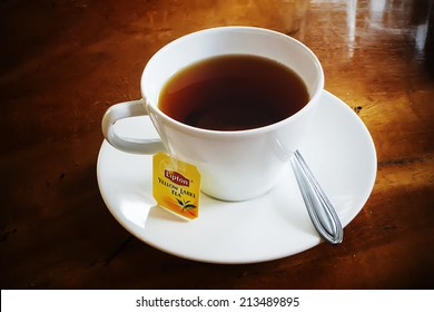 Bangkok, Thailand - Aug. 11, 2014: Lipton Tea cup on table. The Lipton Brand was named after its founder Thomas Lipton.