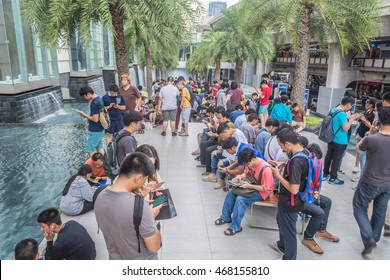 BANGKOK THAILAND - AUG 13: People play Pokemon Go at Siam Paragon on August 13, 2016 in Bangkok, Thailand.