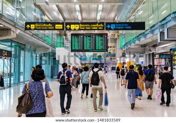 BANGKOK, THAILAND - AUG 15, 2019: Foreign tourists are walking in the Suvarnabhumi International Airport to enter Thailand.