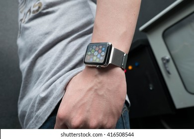BANGKOK, THAILAND - Aug 16, 2015: Man hands with apple watch from outside