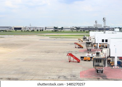 BANGKOK, THAILAND - AUG 2019 : Don-mueang International Airport :Jet bridge or jetway bridge on prepare by ground Service crew ready for passenger depart or arrived.