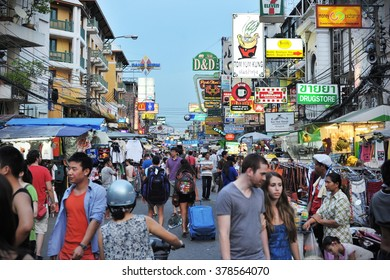 BANGKOK, THAILAND - AUG 23, 2012: Tourists and locals walk along backpacker haven Khao San Road. Budget accommodation in the Thai capital's Khao San area starts from $6 or B200 per night.