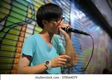 BANGKOK, THAILAND - AUG 23, 2012: A man beatboxes on a city centre street. Hip hop culture and beatboxing has an underground following among Thai youth.