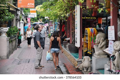 BANGKOK, THAILAND - AUG 23, 2012: Tourists and locals walk along a street near backpacker haven Khao San Road. Budget accommodation in the Khao San area starts from $6 or B200 per night.