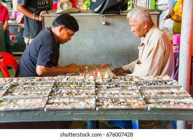 Bangkok, Thailand - Aug 24, 2016 - Unidentified men play chess at amulet market