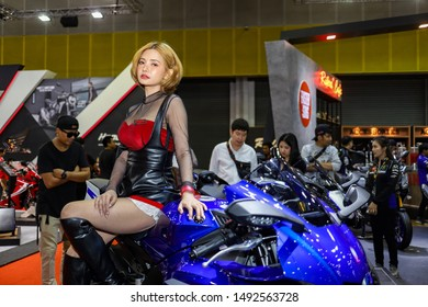 Bangkok, Thailand, Aug 24, 2019 - Pretty Asian model sitting on Yamaha R1 in Bangkok Big Motor Sale