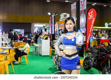 Bangkok, Thailand, Aug 24, 2019 - Asian pretty model presenting a bottle of oil lubricant in motor exhibition