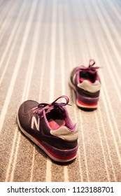 Bangkok, Thailand - Aug 28 2014: Close Up Shot of a Woman's New balance Running Shoes (Purple) in Room