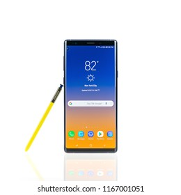 Bangkok, Thailand - Aug 28, 2018: Studio shot of the new Samsung Galaxy Note 9 smartphone in ocean blue color with yellow S-Pen stylus, isolated on white background. Illustrative editorial content.
