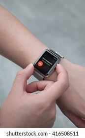 BANGKOK, THAILAND - Aug 29, 2015: Man hands check someone called from apple watch