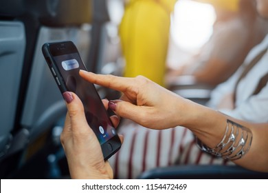 Bangkok, Thailand - Aug 7,2018: Hand holding Apple iPhone 7plus with slide to power off option on the screen before take off on airplane