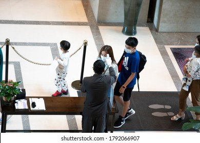 Bangkok, Thailand, Aug,08,2020:Hotel waiter Test for fever with a thermometer Customers staying To prevent the spread of COVID-19