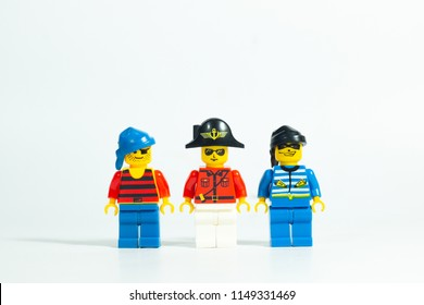 Bangkok Thailand -Aug3,2018: Lego toy mini figures pirate captain and rob team , arresting guilty steal man , on white background . studio shot picture . plastic fun collection for child .
