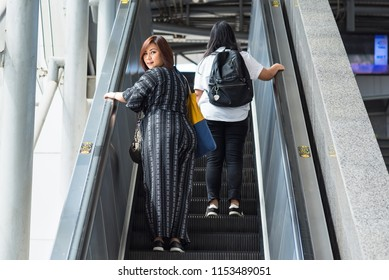 Bangkok, Thailand - August, 04, 2018 : Two woman inside metro station going up on the escalator at Bangkok, Thailand