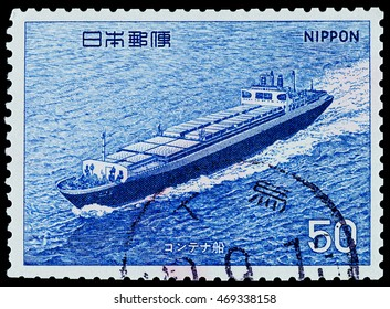 """BANGKOK, THAILAND - AUGUST 06, 2016: A postage stamp printed in Japan shows Container ship, series """"ship"""", circa 1975."""