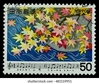 """BANGKOK, THAILAND - AUGUST 06, 2016: A postage stamp printed in Japan shows maple tree and river, series """"Japan Song"""", circa 1979."""