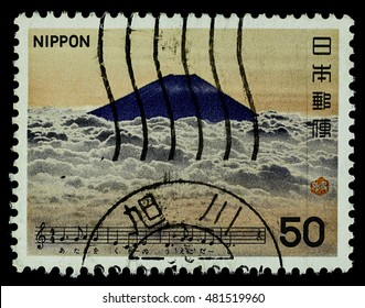 "BANGKOK, THAILAND - AUGUST 06, 2016: A postage stamp printed in Japan shows Mt. Fuji mountain, series ""Japan Song"", circa 1979."