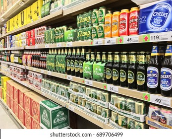 Bangkok, Thailand - August 1, 2017: Shelf of beverage, domestic and imported beer cans and bottles at Big C Super center. Big C Super center is a big supermarket in Thailand