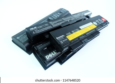 BANGKOK, THAILAND - August 1, 2018 Pile of used Laptop computer Battery or Notebook Battery Many brands ASUS,Lenovo,Dell,HP isolated on white background