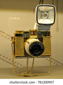 Bangkok, Thailand - August 10, 2012: A golden Diana F+ lomography camera is seen in a shop window display.