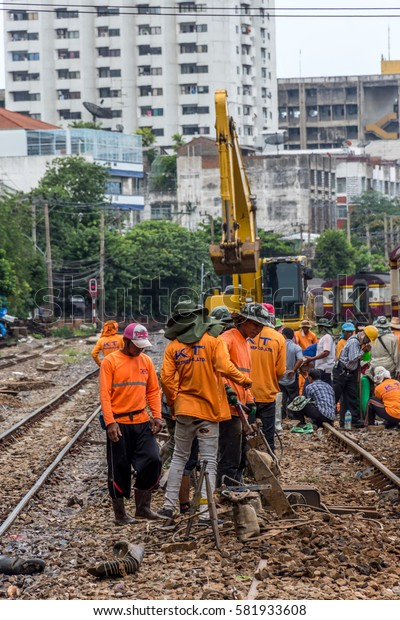 Bangkok, Thailand - August 11, 2016 : Unidentified railway employees working for restoration the railroad tracks before serving at State Railway of Thailand.
