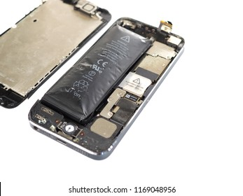 Bangkok, Thailand August 11, 2018: iPhone 5 screen fall off From the machine. Because the battery is swollen on a white background