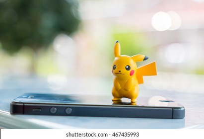 Bangkok, Thailand - August 12, 2016 : pokemon go pikachu real with a smartphone.