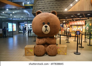 Bangkok, Thailand - August 12, 2017: Giant Size Brown (Bear) Doll in front of LINE Village Store at Siam Square One Shopping Center (the 1st Official LINE Store in Thailand).