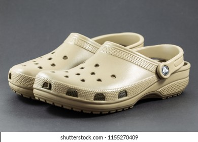 Bangkok, Thailand - August 12, 2018 : A pair of brown Crocs sandals with motif design isolated on black background.